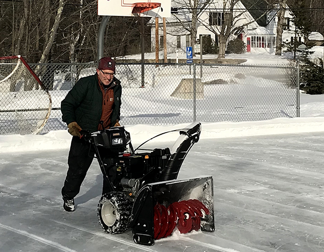 Volunteers Maintain Ice Rink