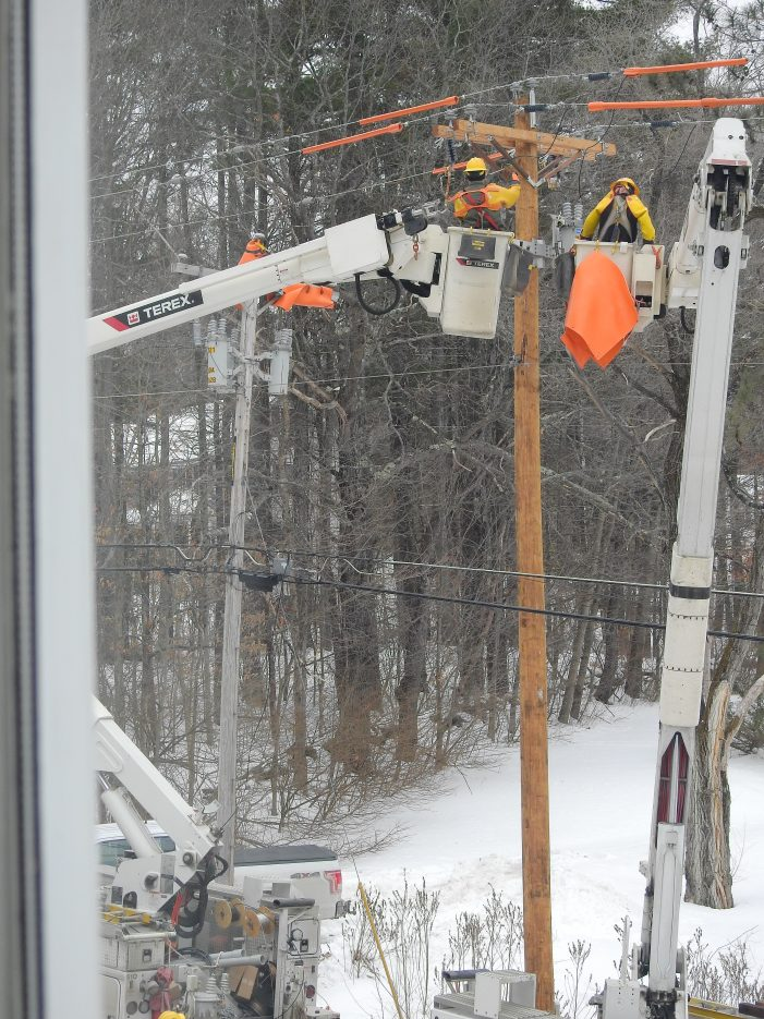 NHEC Installs a New Utility Pole on Chase Hill Road