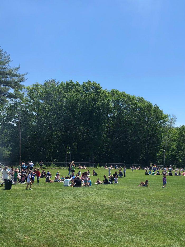Elementary School Students Enjoy a BBQ Lunch on Last Day of School