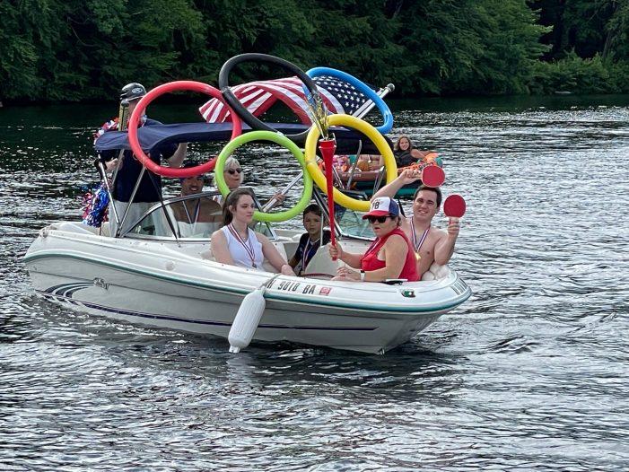 Highland Lake Boat Parade Entrant Sports an Olympics Theme
