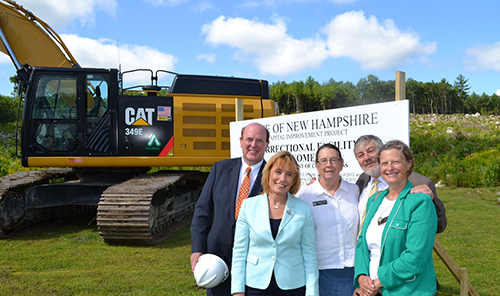 David Campbell, chair of the Public Works and Highways committee; Governor Maggie Hassan; and Maureen Mann, Mario Ratzki, and Karen Ebel, members of the Public Works and Highways committee, pose at the groundbreaking for the new women's prison in Concord.