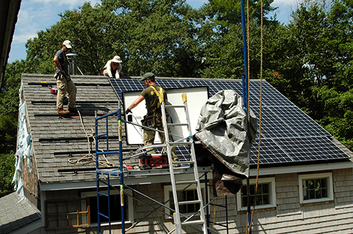 Revision Energy of Exeter installed another photovoltaic array in Andover last month. The 18 panels should provide about 5.4 kilowatts of electricity over the course of a year, enough to power the entire household. Any excess power goes into the New Hampshire Electric Co-op's grid for other NHEC customers to use. Revision recently announced a new program that lets qualified homeowners add solar with no money down. Photo: Charlie Darling