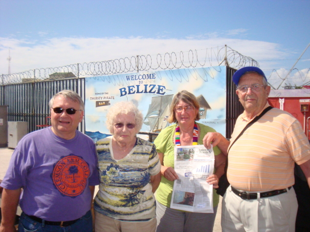 Peter Delaney, Jane Diven, Andrea Delaney, and George Diven pause upon arriving in Belize for a quick photo with the Beacon. Peter and Andrea are George and Jane's son-in-law and daughter.