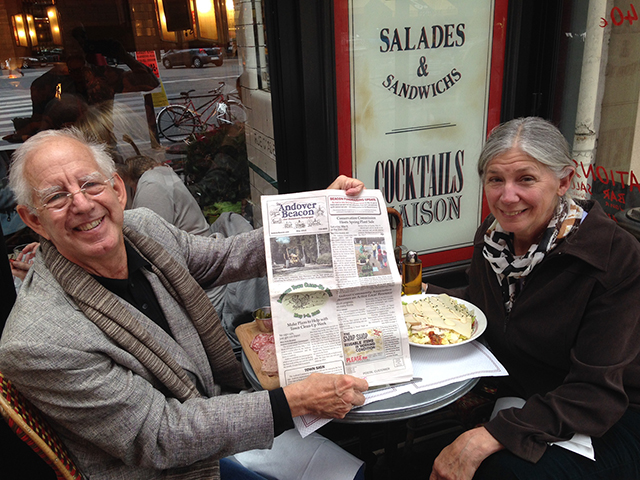 Duncan and Margo Coolidge brought a copy of The Andover Beacon to a small café in the 14th arrondissement of Paris on their recent trip.