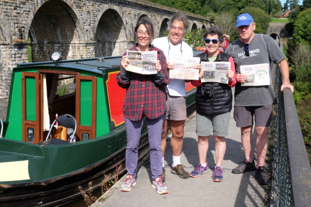 In late August the 4 Agoos siblings, Blue Country – Maple Street, East Andover, and spouses commandeered a narrow boat for a week on the Llangollen Canal in northeast Wales, UK.  Peter brought along several copies of The Beacon to show that our readership loyalties transcend borders!  The photo was taken at the Chirk Aquaduct, that separates Wales from England. Left to right: Julie, Peter, Kathy, and Ted Agoos. Caption: Kathy Agoos
